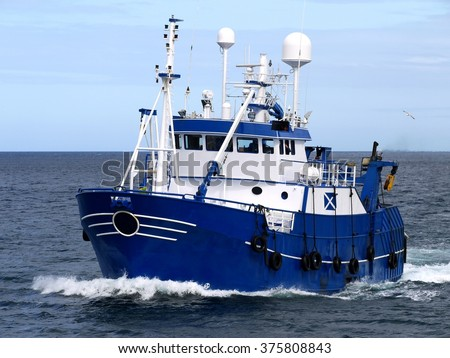 Fishing Vessel underway to harbor to land catch. - stock photo