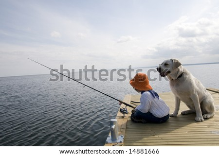 Fishing with Labrador Retriver - stock photo