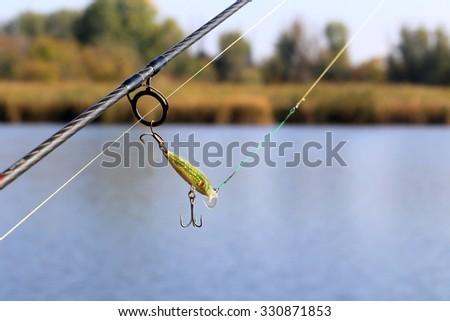 fishing wobbler on rod ring - stock photo