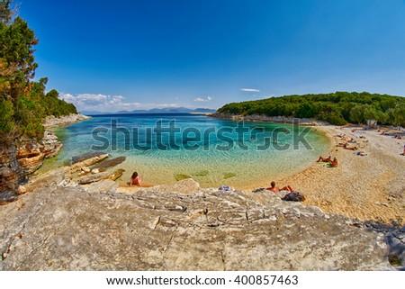 Fiskardo Foki Beach with Crystal Clear Waters Bay - stock photo