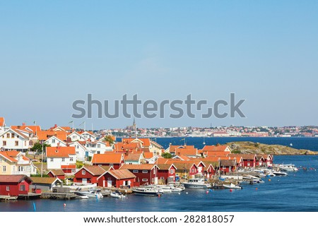 Fiskebackskil an old fishing village on the Swedish west coast, with Lysekil city in the background - stock photo