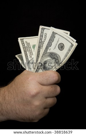 Fist full of money - stock photo