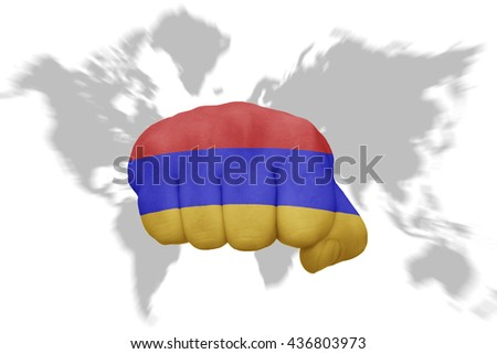 fist with the national flag of armenia on a world map background - stock photo