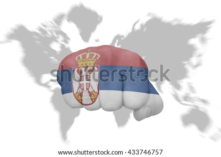 fist with the national flag of serbia on a world map background - stock photo