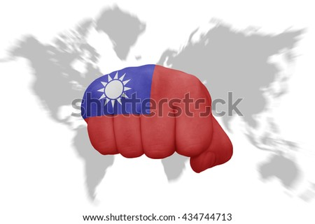 fist with the national flag of taiwan on a world map background - stock photo