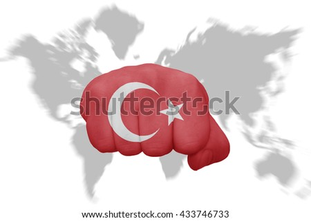fist with the national flag of turkey on a world map background - stock photo