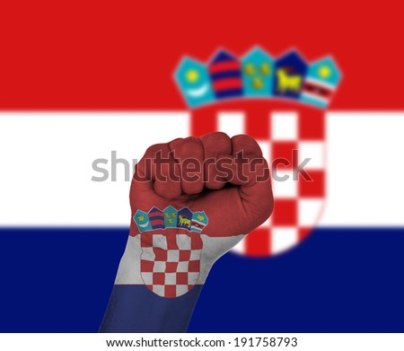 Fist wrapped in the flag of Croatia and flag in the background - stock photo