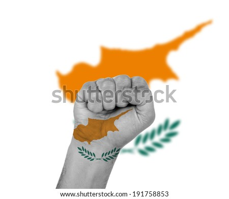 Fist wrapped in the flag of Cyprus and flag in the background - stock photo