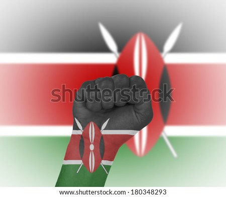 Fist wrapped in the flag of Kenya and flag in the background - stock photo