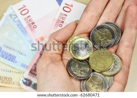 fistful of money - stock photo