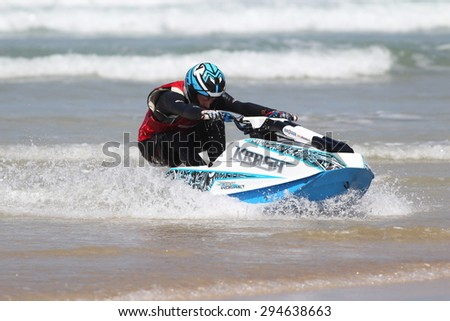 Fistral Beach, Newquay, Cornwall, UK. 6th June, 2015. Professional jet ski riders compete at the IFWA World Tour Jet Ski Championship. A contestant leans back to slow down as he comes into shore. - stock photo