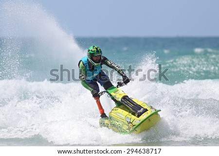 Fistral Beach, Newquay, Cornwall, UK. 6th June, 2015. Professional jet ski riders compete at the IFWA World Tour Jet Ski Championship. A disabled contestant performs tricks for judges in the waves. - stock photo