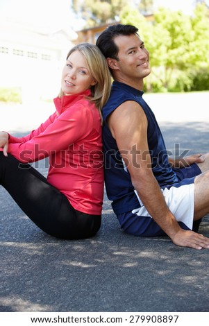 Fit, active couple outdoors - stock photo
