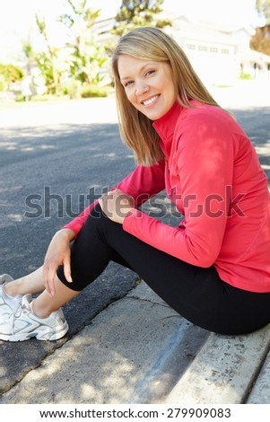 Fit, active woman outdoors - stock photo