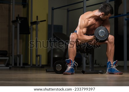Fit Athlete Doing Exercise For Biceps - stock photo