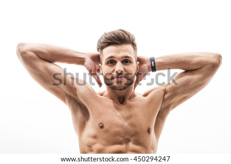 Fit athletic man doing sit-ups - stock photo