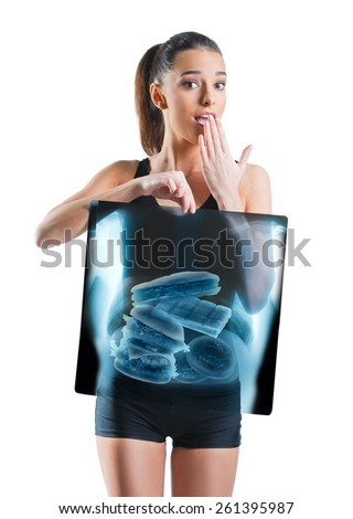 Fit, beautiful woman holding an x-ray of stomach - stock photo