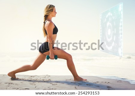 Fit blonde doing weighted lunges on the beach against fitness interface - stock photo