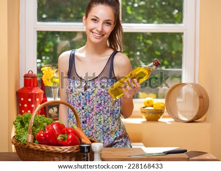 Fit brunette beauty preparing healthy food in the kitchen. - stock photo