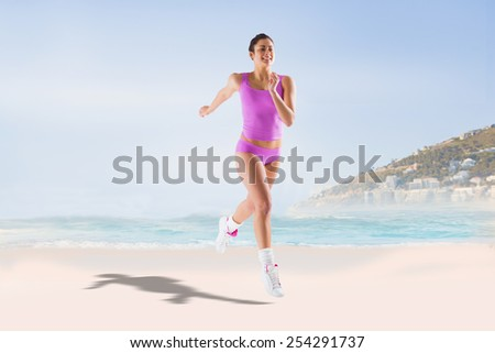 Fit brunette running and jumping against beautiful beach and blue sky - stock photo