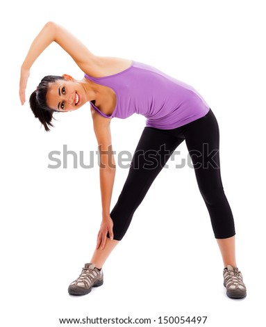 Fit brunette woman showing how to keep fit doing warming up exercises. - stock photo