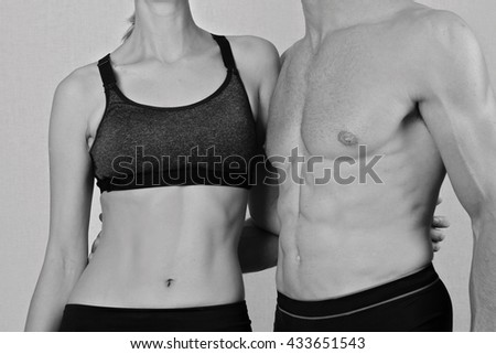 Fit couple, strong muscular man and slim woman . Sport, fitness ,workout concept. Love, togetherness, relationship - stock photo