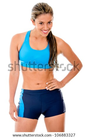 Fit female athlete smiling - isolated over a white background - stock photo