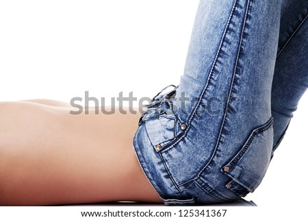 Fit female body in blue jeans, isolated on white - stock photo