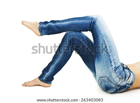 Fit female body in blue jeans. Isolated on white background - stock photo