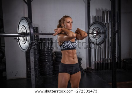 Fit girl performing front squat. - stock photo