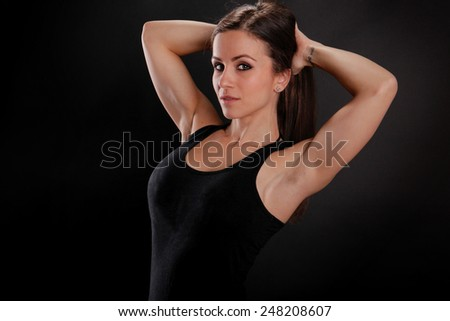 Fit girl stretches her arms - stock photo