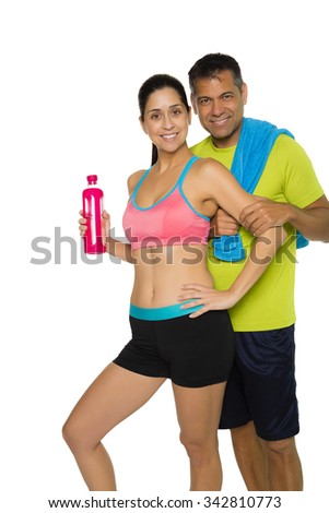 Fit Hispanic couple in workout attire, copy space - stock photo