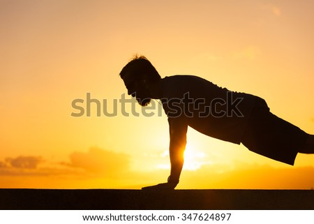 Fit male doing push ups.  - stock photo