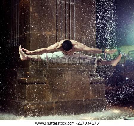 Fit man exercising at night - stock photo