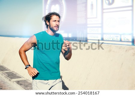Fit man jogging on promenade against fitness interface - stock photo