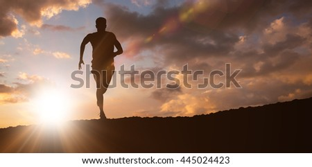 Fit man running against white background against clouds - stock photo