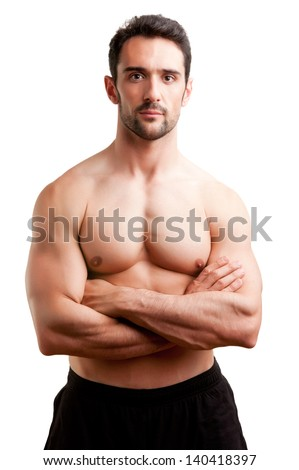Fit man standing shirtless with his arms crossed in a white background - stock photo