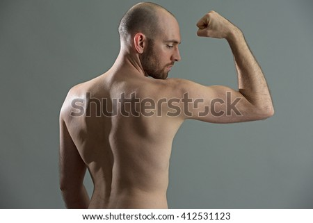 Fit man training his biceps - stock photo
