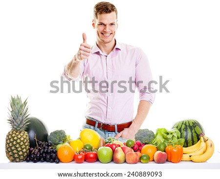 Fit man with healthy food - vegetables and fruits isolated on white background - stock photo