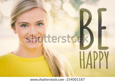 Fit smiling blonde looking at camera against be happy - stock photo