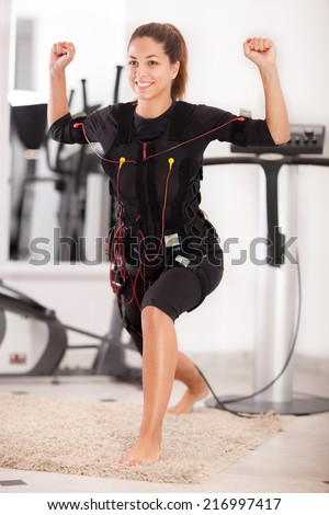 fit woman exercise on electro muscular machine - stock photo