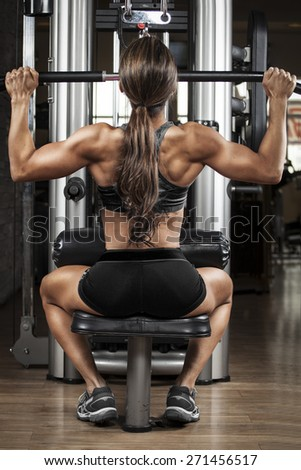 Fit woman exercising at a machine - stock photo