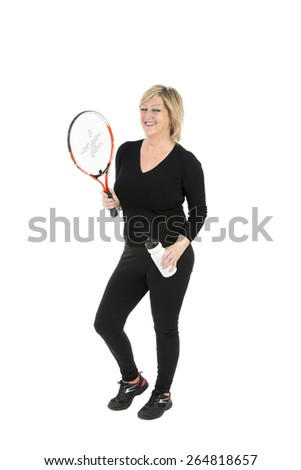 Fit woman holding a tennis racket and a water bottle against a white background - stock photo