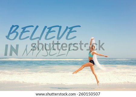 Fit woman jumping gracefully on the beach with scarf against believe in myself - stock photo