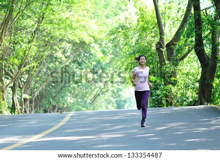 fit woman runner running - stock photo