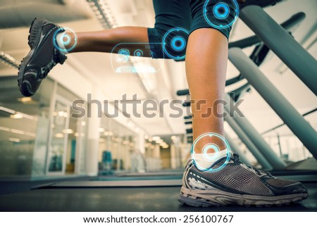 Fit woman running on the treadmill against fitness interface - stock photo