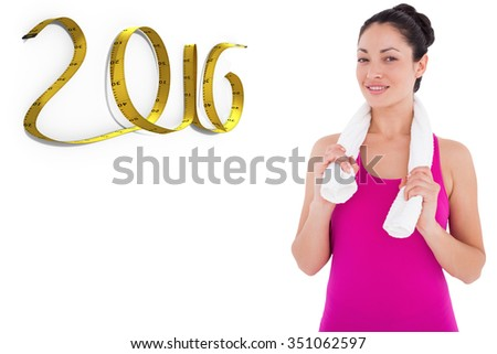 Fit woman smiling at camera against white background with vignette - stock photo