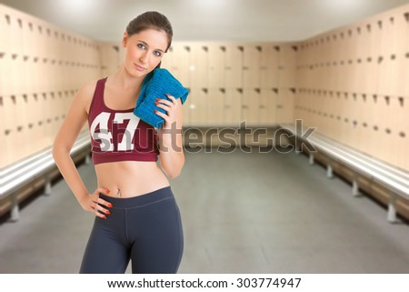 Fit woman standing with her arms at her waist - stock photo