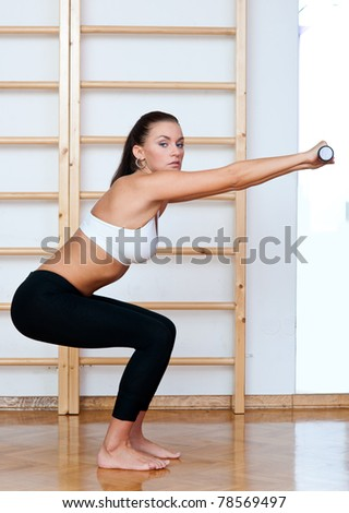 fit woman workout with weights in fitness studio - stock photo