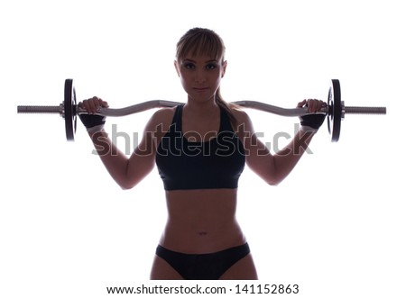 Fit young woman doing shoulder press exercise with a weight bar, isolated on white - stock photo